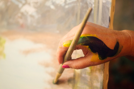brush in: Brush in a painters hand