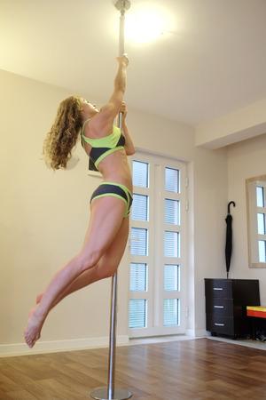 sport hall: Gimnast trains in a sport hall Stock Photo