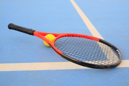 Raquet: The image of tennis ball and tennis racket