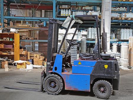 mini loader: Interior of a warehouse Stock Photo