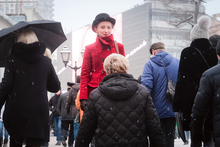 homo sapiens: Girl in a red coat