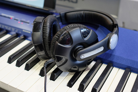 handsfree phone: headphones isolated under the light background Stock Photo