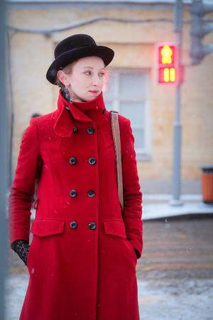 sapiens: Girl in a red coat in a city
