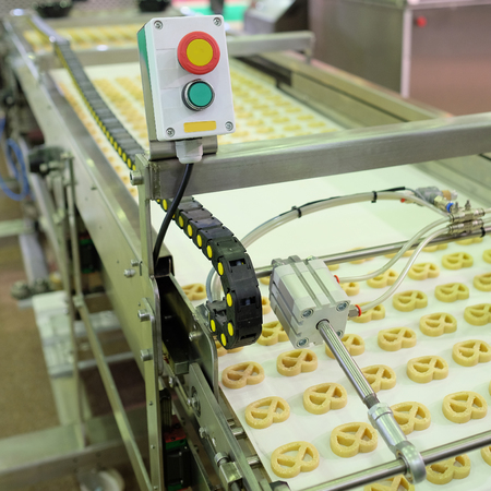 semimanufactures: image of a baking machine Stock Photo