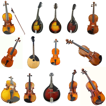 violins: The image of violins and mandolins under the white background Stock Photo