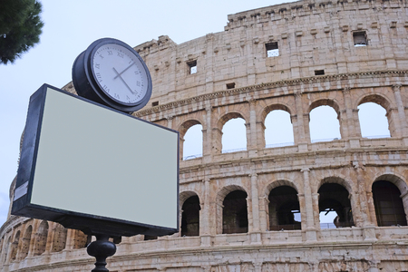 Roma: The image of ? clock against the Colosseum in Roma, Italy