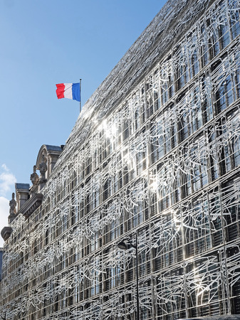 metall and glass: Paris, France, February 9, 2016: house in Paris, France, with the France flag on its flat