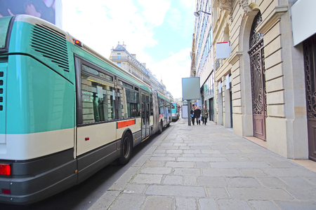 motor de carro: Paris, France, February 6, 2016: Bus  stop on the street of Paris, France