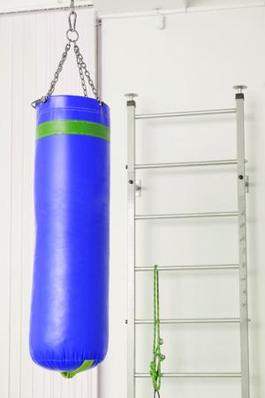 wall bars: The image of a wall bars and spunching bag Stock Photo