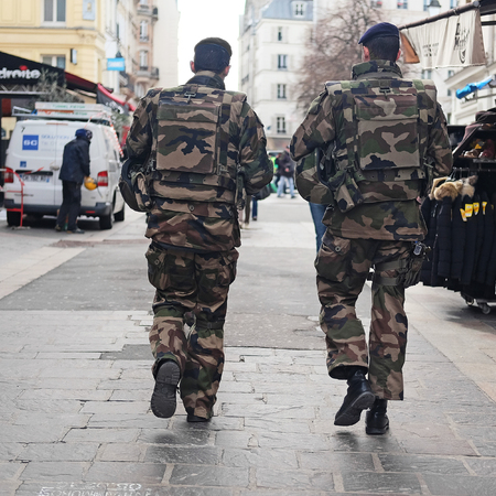 millitary: Paris, France, February 9, 2016: millitary patrol on a street in a center of Paris, France.