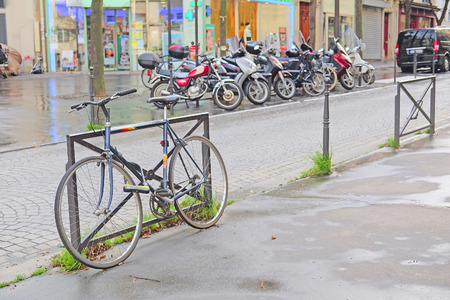 two wheel: Paris, France, February 6, 2016: bicycle on a parking in Paris, France. In this city bicycle is one of the main vehicles.