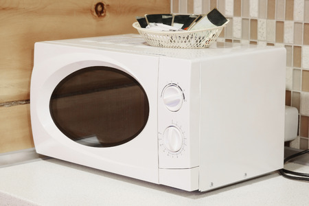 timescale: Close-up microwave  on the table