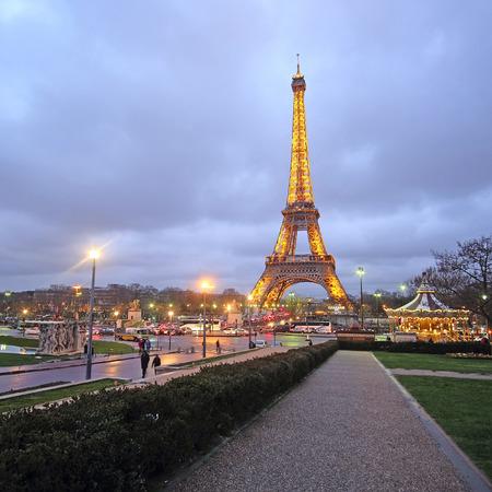 simbols: Paris, France, February 12, 2016: Eiffel tower at a night in Paris, France. Eiffel tower is one of the simbols of this city Editorial