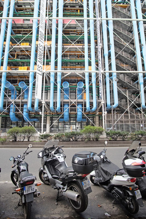 a two wheeled vehicle: Paris, France, February 7, 2016: Building of Georges-Pompidou center in Paris, France