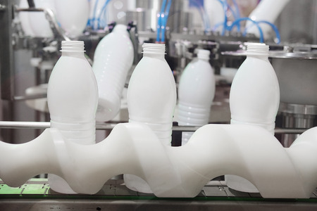 enginery: The image of a milk packing machine Stock Photo