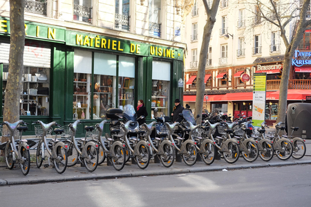 bycicle: Paris, France, February 9, 2016: bycicle parking in a center of Paris, France Editorial