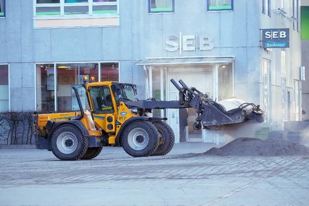scandinavian peninsula: Stockholm, Sweden - March, 16, 2016: autoloader works on a street of Stockholm, Sweden Editorial