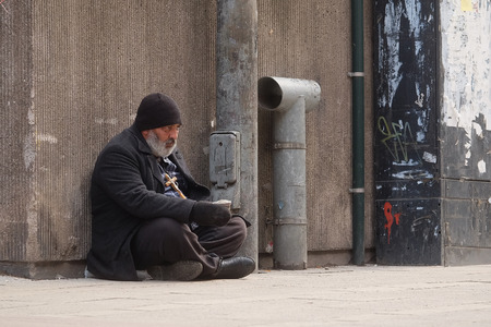 raggedy: Helsinki, Finland - April, 4, 2016: homeless person in a center of Helsinki, Finland.