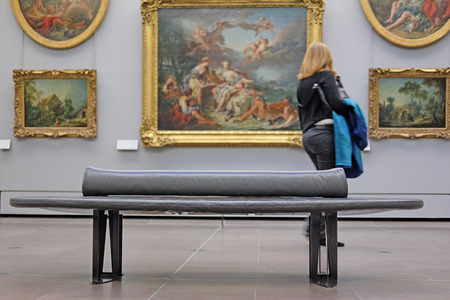 visitors: Paris, France, February 10, 2016: visitors look at the pictures in Louvre, Paris, France Editorial