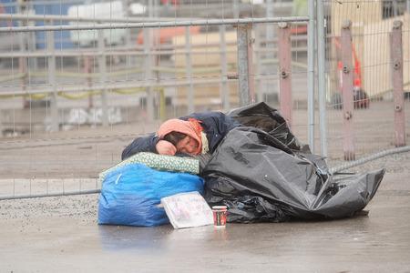 social outcast: Stockholm, Sweden - April, 6, 2016: homeless woman in Stockholm, Sweden