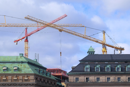 housetop: Stockholm, Sweden - March, 17, 2016: Panorama of Stockholm, Sweden with tower cranes