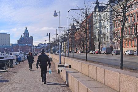 scandinavian peninsula: HELSINKI, FINLAND - April, 4, 2016: traffic on a street of Helsinki, Finland.