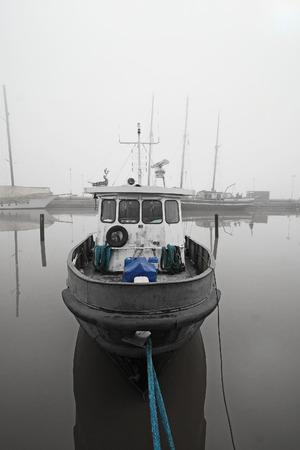 scandinavian peninsula: boat in a fog in Helsinki, Finland