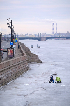piter: St. Petersburg, Russia - on March, 13, 2016: Fisherman on an ice of Neva river in St. Petersburg, Russia. Editorial