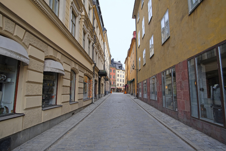 scandinavian peninsula: Stockholm, Sweden - March, 16, 2016: landscape with the image of Old Town street in Stockholm, Sweden