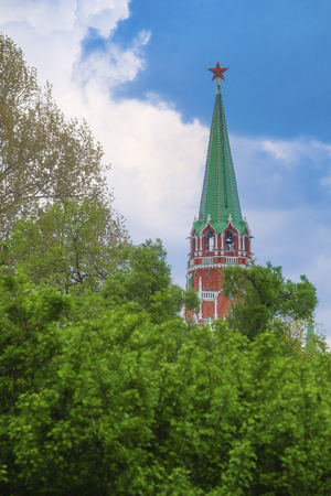 chiming: Moscow, Russia - May, 6, 2016: view of a Moscow Kremlin tower under the trees