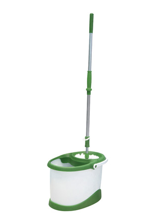 broom handle: mop and a bucket under the light background