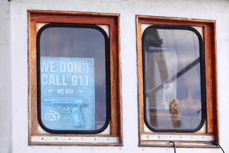 scandinavian peninsula: Stockholm, Sweden - March, 16, 2016: Prevention We dont call 911, we use gun on a window of private boad in Stockholm, Sweden