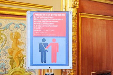 petty theft: Paris, France - Februare, 10, 2016 - prevention table with danger warning of a robbery pickpockets in Louvre about the dengerouse Editorial