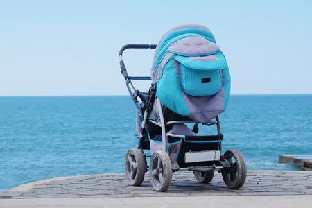 perambulator: Perambulator on a sea beach