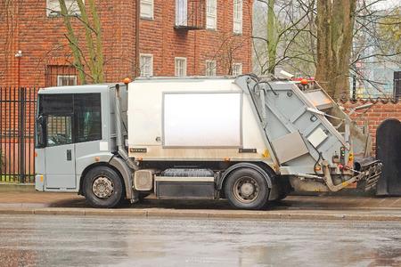 recolector de basura: Stockholm, Sweden - April, 4, 2016: sanitation truck in Stockholm, Sweden