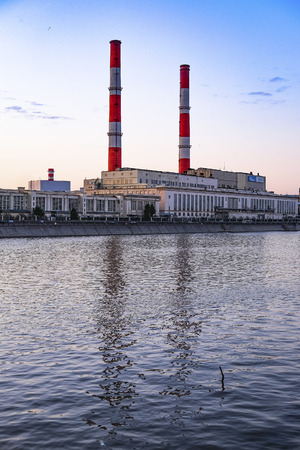 urban decline: Moscow, Russia - May, 14, 2016: Embankment of Moscow river with the image of power plant in Moscow, Russia