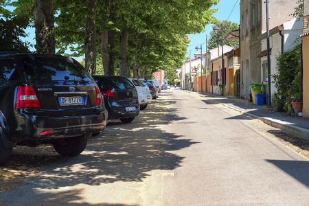 adria: Adria, Italy - June, 29, 2016: cars on a parking in Adria, Italy Editorial