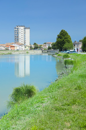adria: Adria, Italy - June, 29, 2016: embankment of Canalbianko chanel in a center of Adria, Italy Editorial