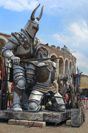 siervo: VERONA, ITALY - JULY, 2, 2016: sculpture of Gladiator infront of Arena of Verona (in Italian it is called Arena di Verona) - ancient amphitheatre used today as a stage for concerts and Opera performances