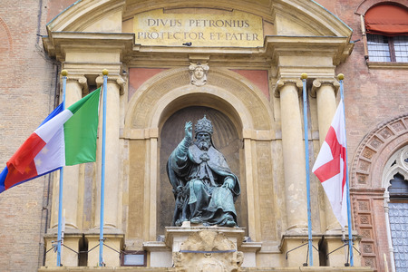 enzo: BOLOGNA , ITALY - DECEMBER 28, 2015 : Pope Gregory XIII statue on King Enzo palace at Bologna main square