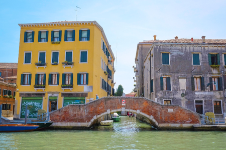 Venice, Italy, June, 21, 2016: landscape with the image of boats on a channel in Venice, Italy Editorial