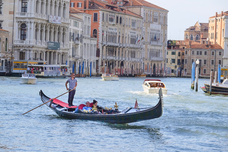 cruise travel: Venice, Italy, June, 21, 2016: gondola sails down the channel in Venice, Italy. Gondola is a traditional transport in Venice, Italy