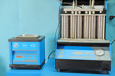 injector: The image of a car injector diagnostic and repair machine