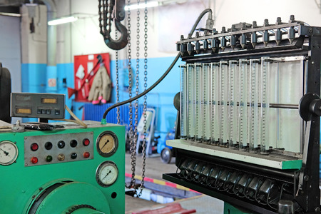 injector: The image of a diesel injector diagnostic and repair machine Stock Photo