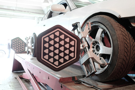 Moscow, Russia - Wheel alignment equipment on a car wheel in a repair station in Moscow, Russia