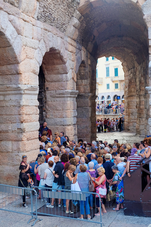 spectators: VERONA, ITALY - JULY, 4, 2016: crowd of spectators near the Arena of Verona entrance (in italian - Arena di Verona) - ancient amphitheater, today used as a theatre stage Editorial