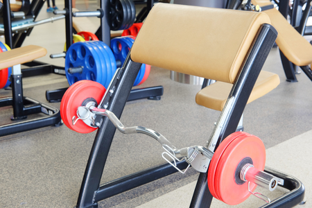 The image of a barbell and gym bench