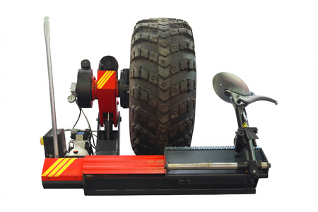 pneumatic tyres: The image of a truck wheel on a tire machine