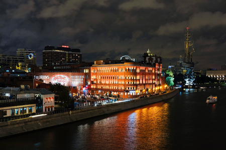 piter: Moscow, Russia - September, 17, 2016: night landscape with the image of the Moskow (Moskva) River embankment and the Piter the Thirst Monument