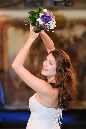 Portrait of a bride with a flower bunch